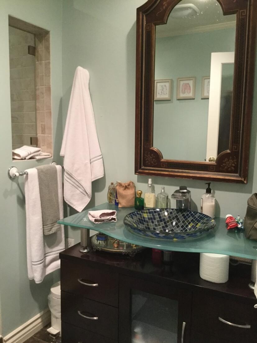Remodeled en suite bath with spa shower & designer sink.