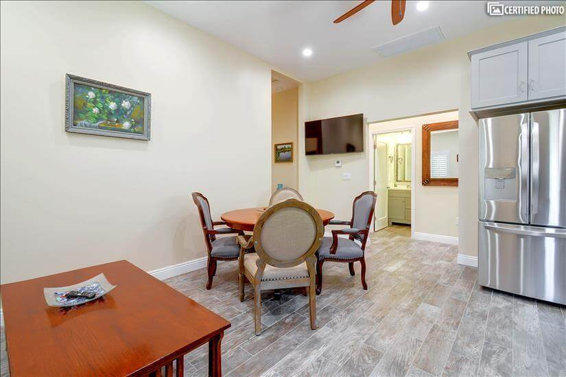 living/dining area with 50 inc flat screen TV