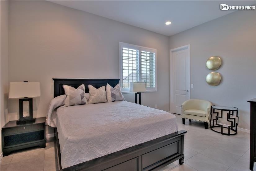 bedroom in guest suite with queen bed.