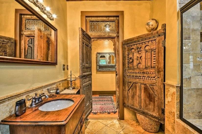 Bathroom with antique Moroccan doors