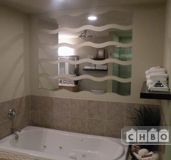 Spacious spa retreat bath quarters has an oversized jacuzzi