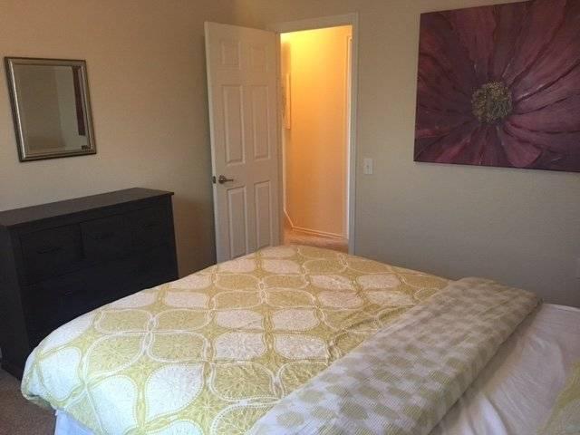 Bedroom #2 has a dresser and walk-in closet