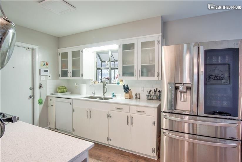 Plenty of fridge space and deep sink area.