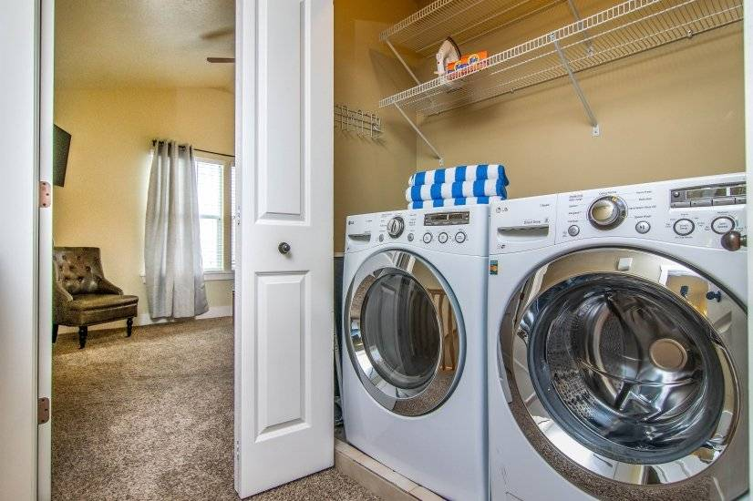 Laundry with nice front loading washer and dryer