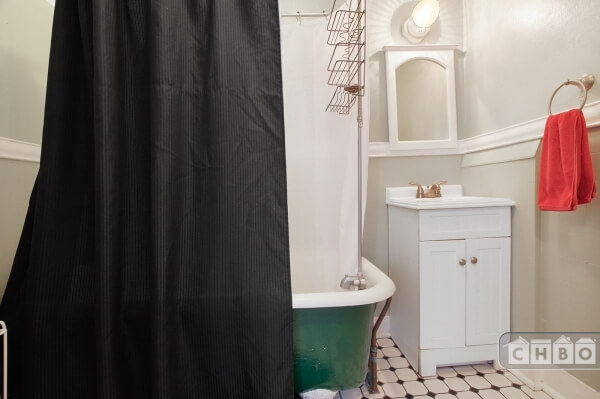 Charming bathroom with clawfoot tub.