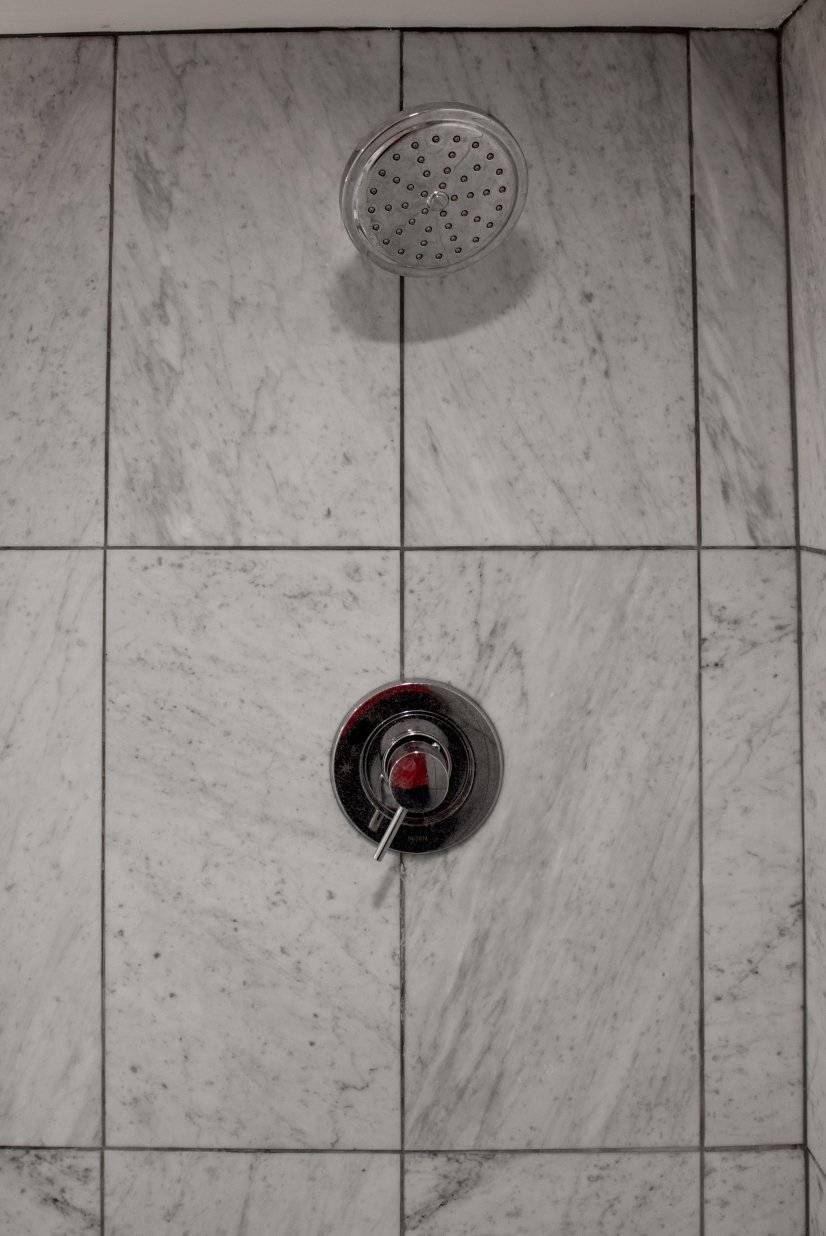 Carrera marble shower with rain shower head