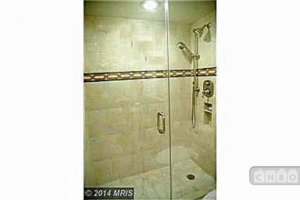 Glass enclosed shower with two shower-head options