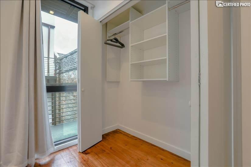 Custom-built closet in guest bedroom