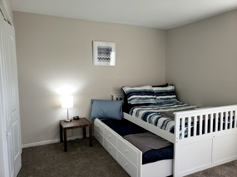 downstairs bedroom has full bed w/ twin trundle