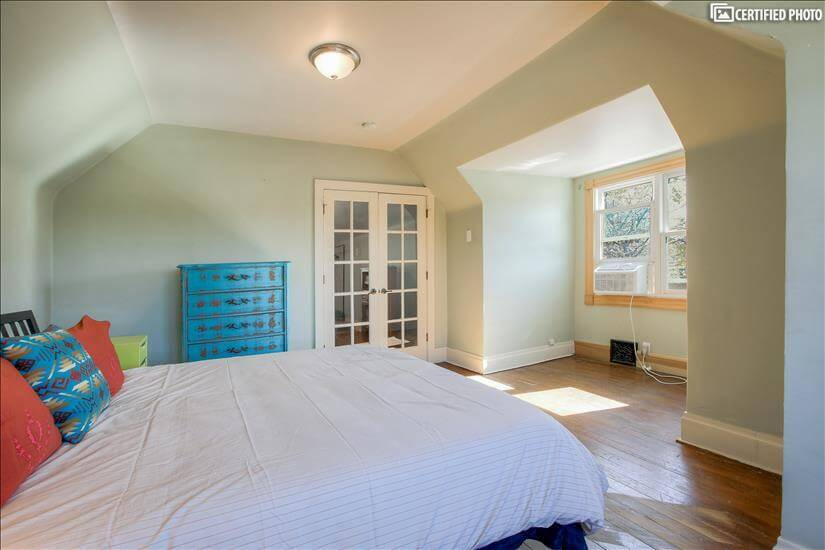 Upstairs - french doors divide bedroom from bathroom area