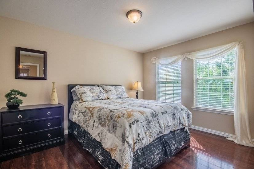 This room has queen size bed, dresser and double closet.
