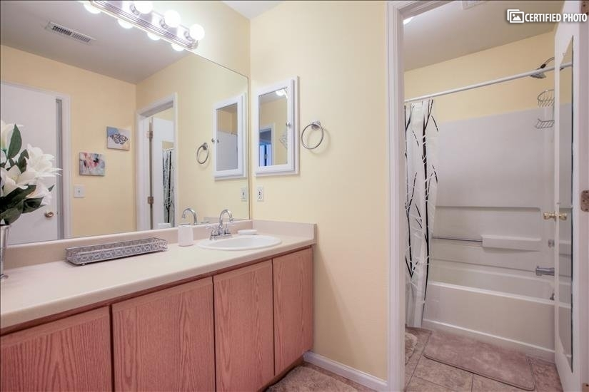 Full bath locks off from vanity area