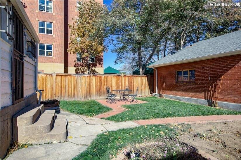 Patio area between house and detached 2-car garage