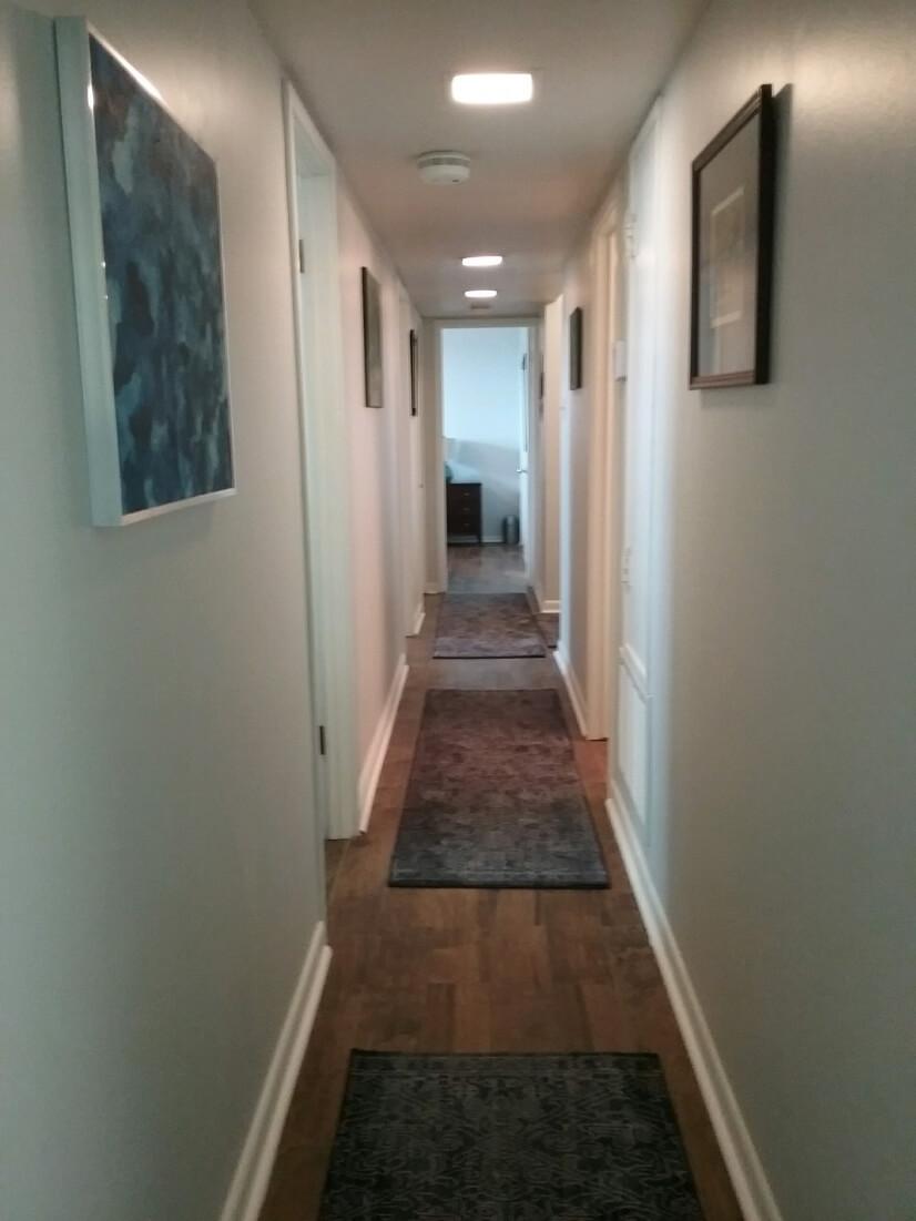 Main hallway with ceramic wood floors through