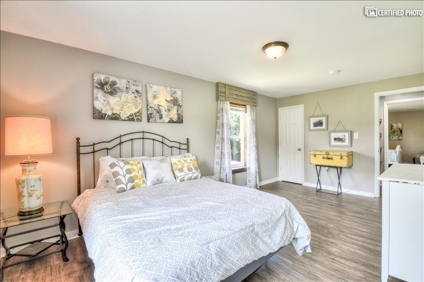 Bedroom 1 with queen bed and plenty of storage