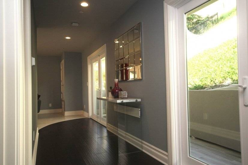 Wide hallway with 2 french doors to the back balcony