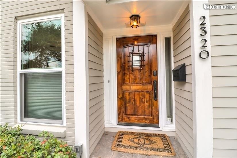 Entrance Door - Solid Wood and Peek out window on the door