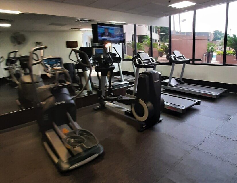 Large workout room with cardio and weights