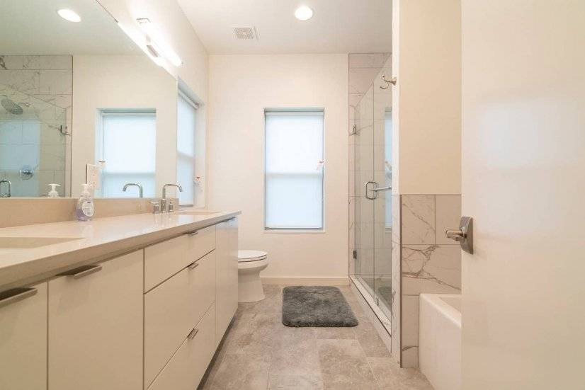 Master bathroom with shower, bathtub and two sinks