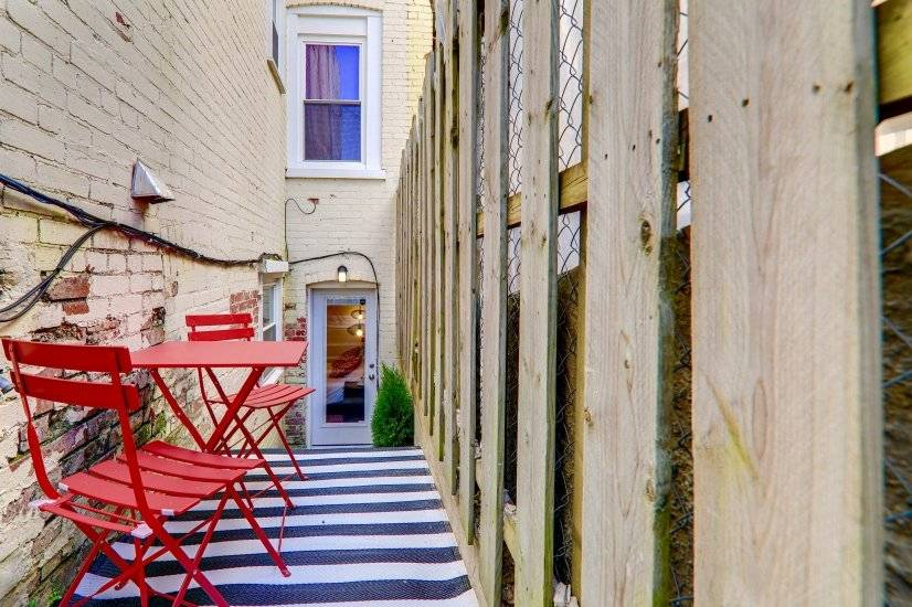 Cute red back patio for work or dining