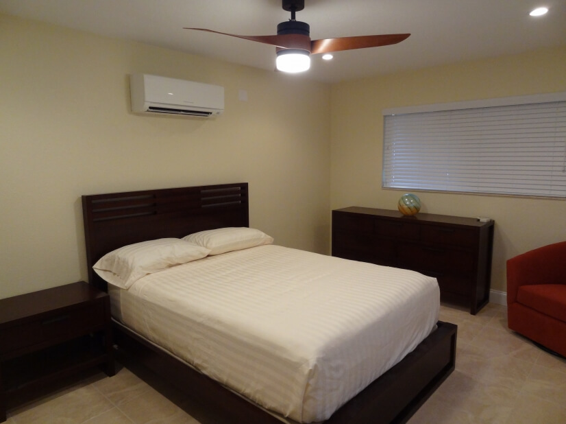 Large bedroom with luxury mattress, mini-split A/C and TV