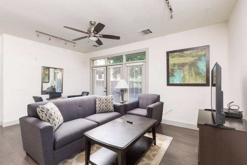 Living room w/ sleeper sofa (queen) and Roku TV