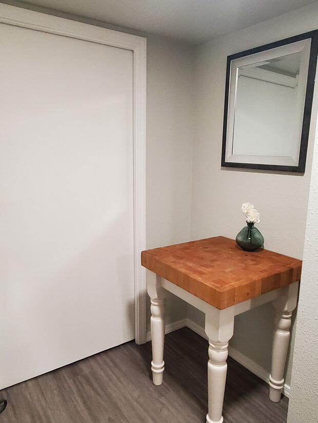 Butcher block table and entry to laundry area