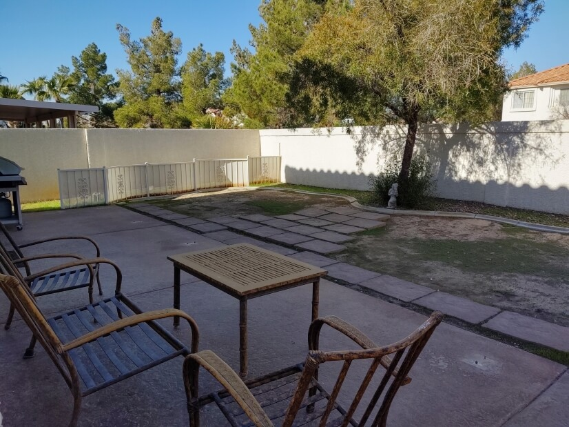 Backyard seating area & patio (cushions are i