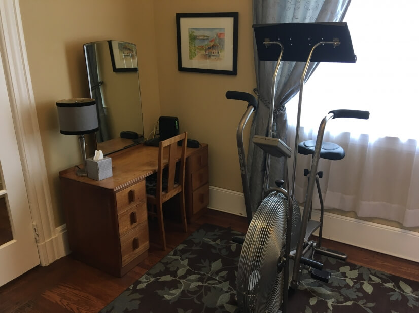 Bedroom with Exercise Bike and Desk