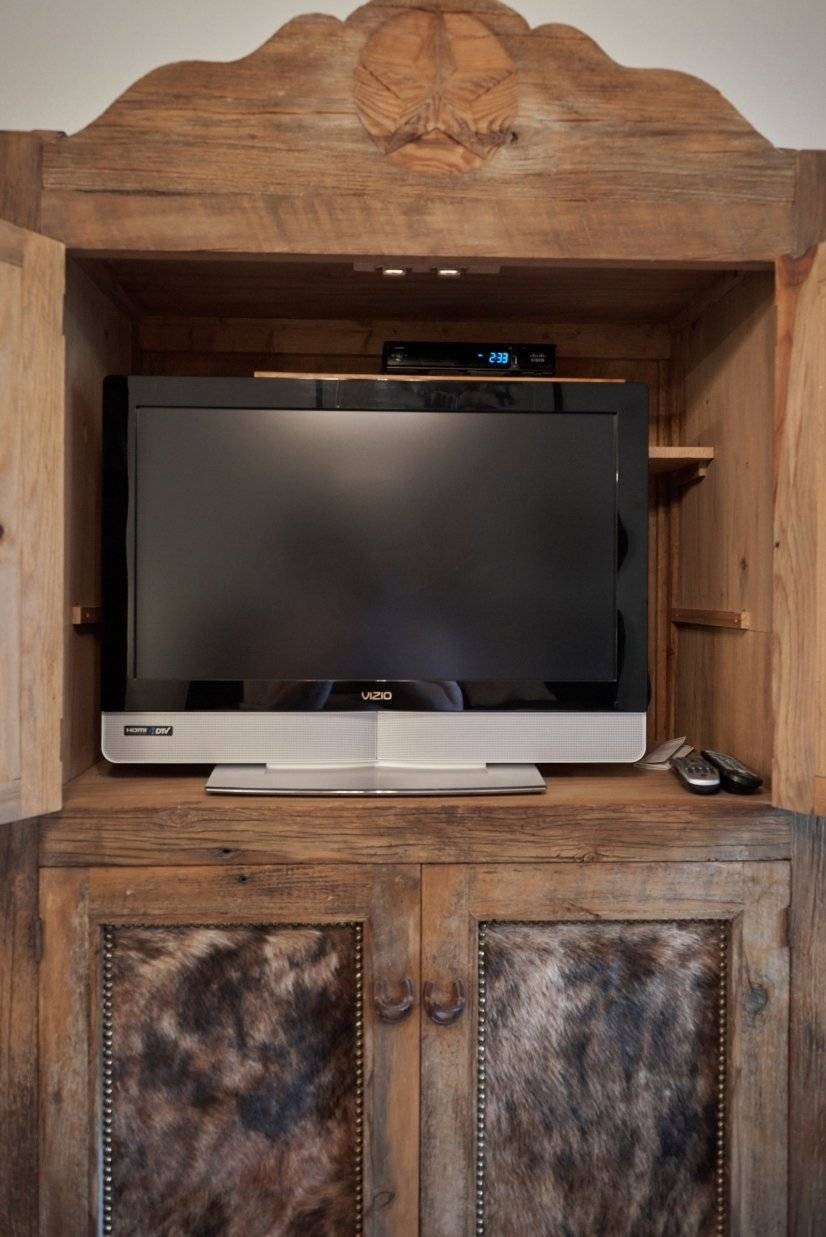 Cowhide cabinet with flat screen tv in master bedroom
