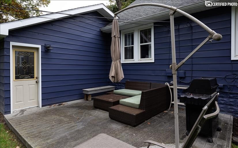 Attached patio with gas grill, large umbrella