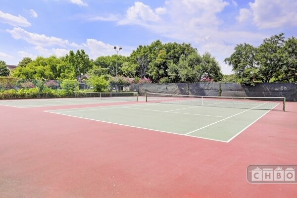 2 tennis courts on property.