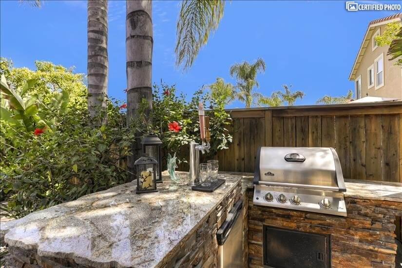 Outdoor barbecue and refrigerator area.
