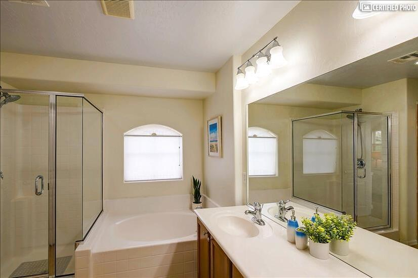 Master bath with walk in shower and Bubble ba