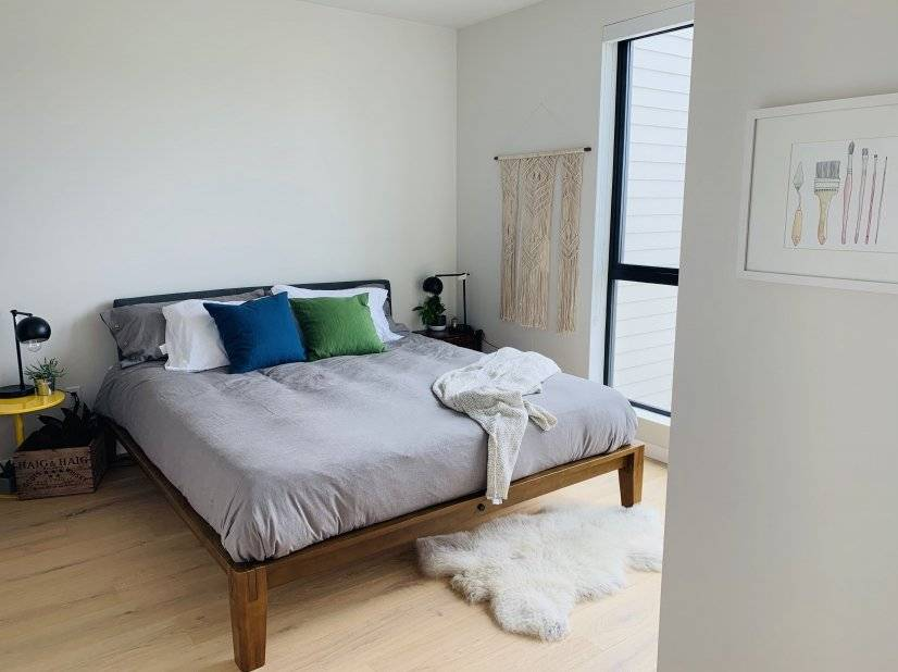 Master bedroom w/ down duvet, pillows, and luxurious linens