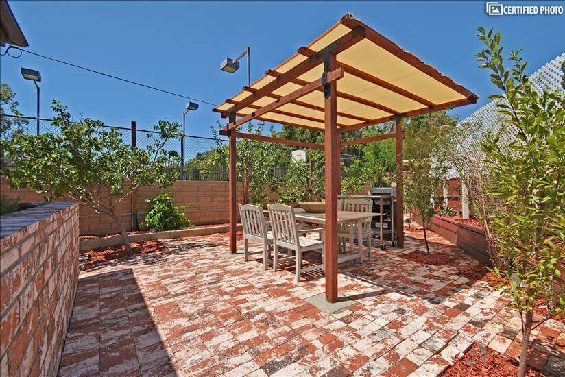 Outdoor living space with dining table and barbecue