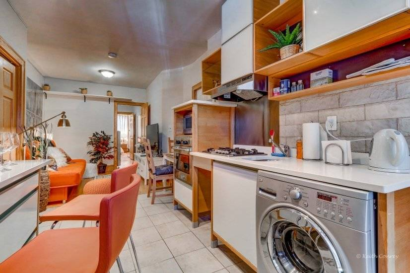 Kitchen with washer / dryer