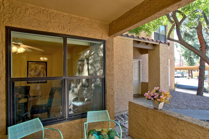 Back patio with windows opening to dining are