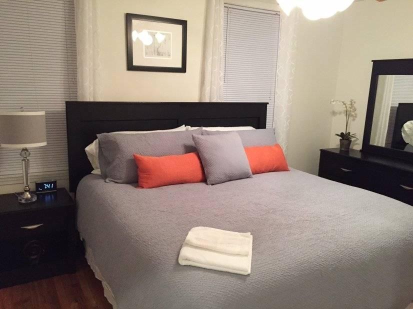 Bedroom 3, night stand, lamp, alarm clock, ceiling fan