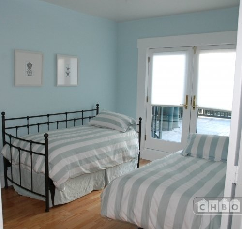 Twin bedroom with French doors leading to Bal