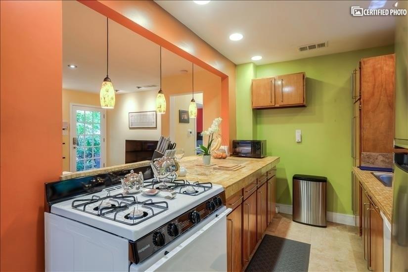 Stove, Travertine Counter, Microwave