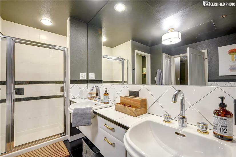 Double sinks, extended vanity provides extra storage