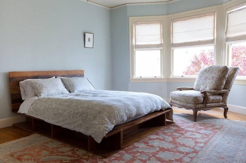 Master bedroom with west facing windows overlooking garden.