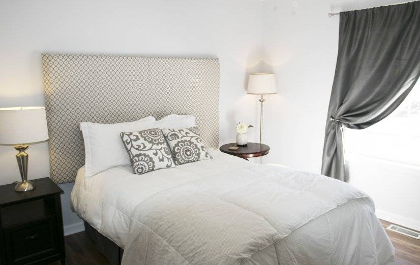 Guest bedroom with full bed and large closet.