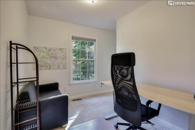Small office with bright window.