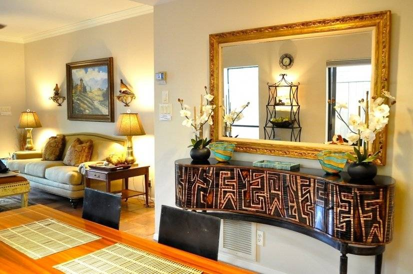 Hand carved mirror and console accent Dining Room