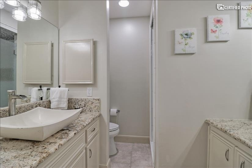 Master Bathroom - Single Sink and extra Vanity.