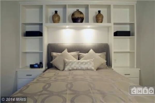Bedroom with custom-built in book case & USB charging outlet