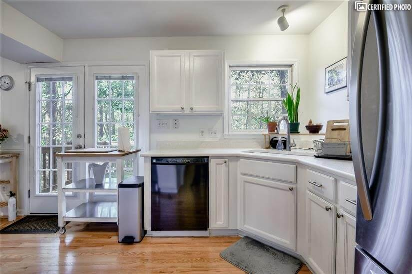Open kitchen, overlooking wooded lot