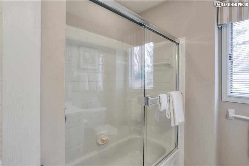 Second floor tub shower glass enclosure.